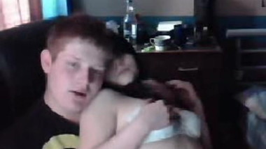 Young couple having fun in front of the webcam