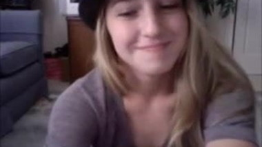 Stylish girl with hat fingering on cam