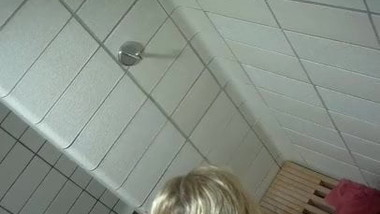 Blonde girl taking a shower